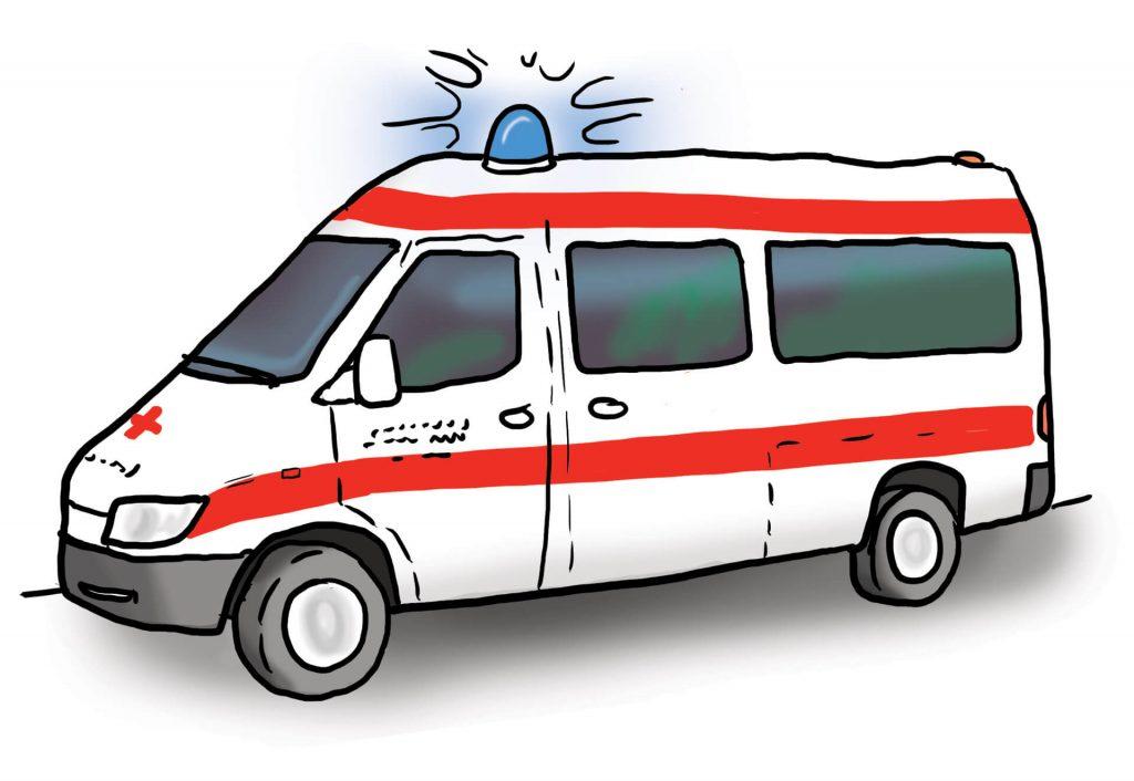 Ein Krankenwagen. Das Blaulicht auf dem Dach leuchtet.