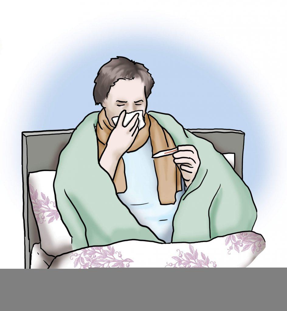 Eine Patientin sitzt krank im Bett und niest